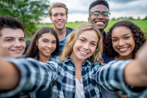 Diverse group of students taking a selfie